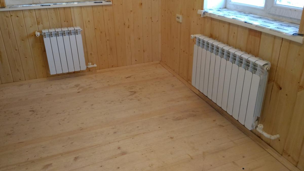 Биметаллические радиаторы в доме из оцилиндрованного бревна